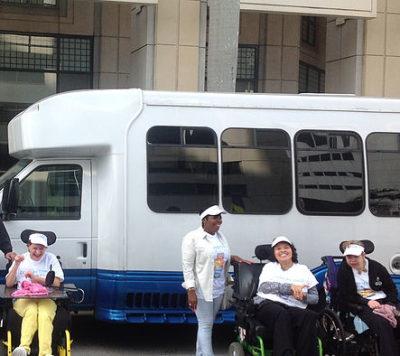 group of people in front of van