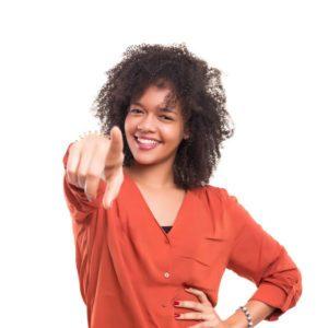 Woman pointing at camera.